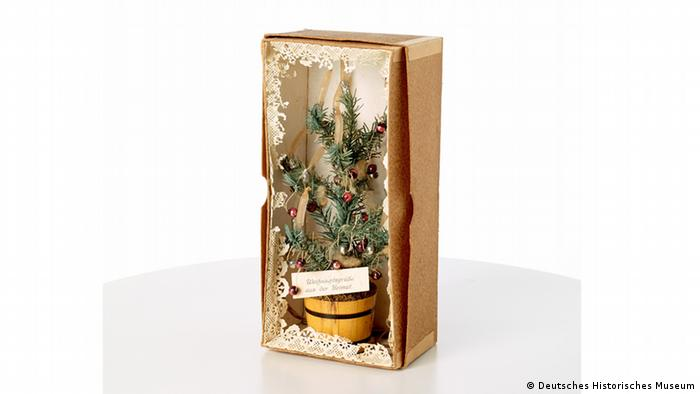 A miniature Christmas tree in a care package box (DHM)