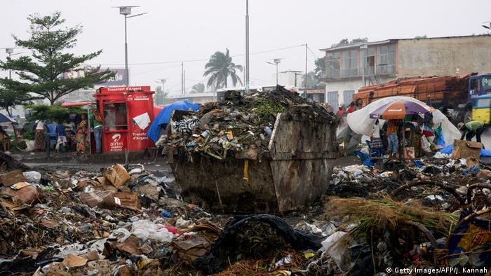 Garbage overflowing from a container in a street of Kinshasa