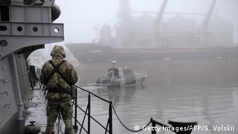 Three Ukrainian navy vessels were seized off the coast of Crimea by Russian forces, which fired on and boarded Kiev's ships after several tense hours of confrontation.