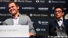 181128 Magnus Carlsen of Norway and Fabiano Caruana of USA after the tie-break game of FIDE World Chess Championship 2018 between Magnus Carlsen and Fabiano Caruana on November 28, 2018 in London. Photo: Jon Olav Nesvold / BILDBYRüN / kod JE / 160368 PUBLICATIONxNOTxINxDENxNORxSWExFINxAUT Copyright: JONxOLAVxNESVOLD BB181128JE023