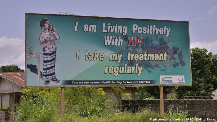 Sign with the inscription I am living positively with HIV