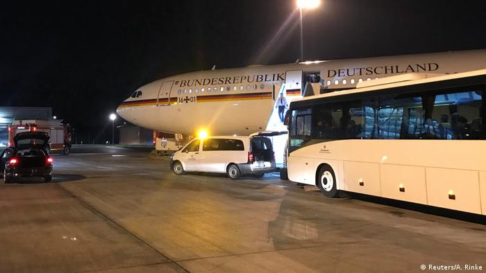 A bus near the grounded government plane