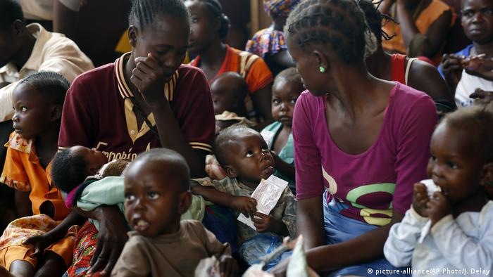 Adults and children at a feeding center near Banjul