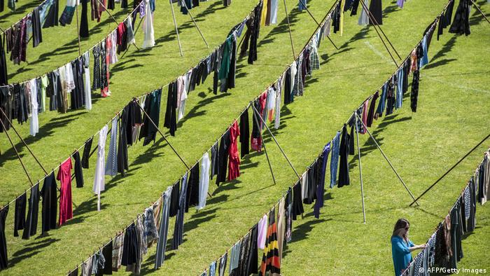 Alketa Xhafa Mripa hangs dresses on clotheslines at the Pristina stadium as part of her installation titled Thinking of You