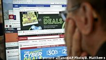 A journalist looks at a computer screen with webpages arranged to show Cyber Monday deals by various online retailers Monday Nov. 26, 2018, in New York. The physical rush of Black Friday and the armchair browsing of Cyber Monday are increasingly blending into one big holiday shopping event as more customers buy items online and pick them up at brick-and-mortar stores. (AP Photo/Bebeto Matthews) |