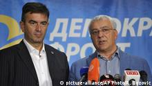 Nebojsa Medojevic (l) talks to reporters alongside ally Andrija Mandic (picture-alliance/AP Photo/R. Bozovic)