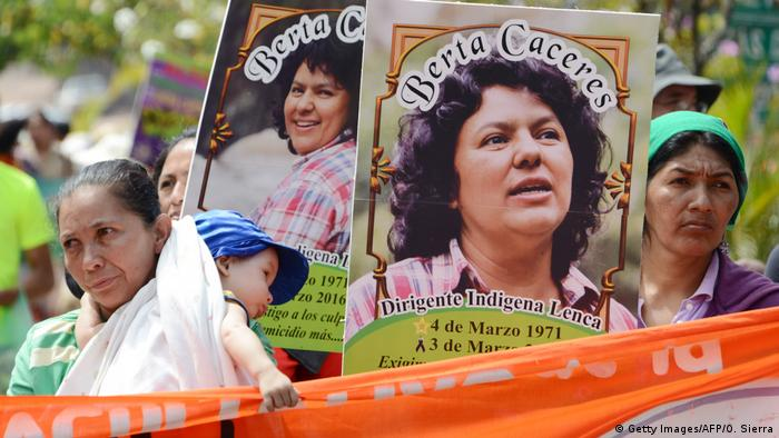 Women hold up pictures of murdered environmental activist Berta Caceres during a demonstration in Honduras