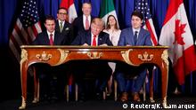 30.11.2018 *** U.S. President Donald Trump, Canada's Prime Minister Justin Trudeau and Mexico's President Enrique Pena Nieto attend the USMCA signing ceremony before the G20 leaders summit in Buenos Aires, Argentina November 30, 2018. REUTERS/Kevin Lamarque