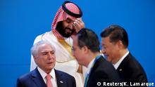 Saudi Crown Prince Mohammed bin Salman looks down as leaders arrive for a family photo at the G20 in Buenos Aires, Argentina November 30, 2018. REUTERS/Kevin Lamarque