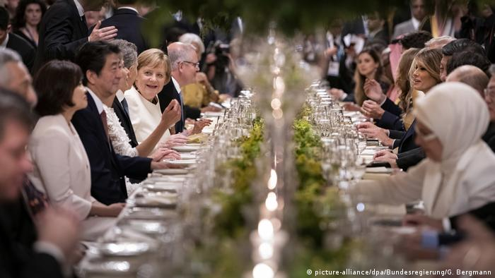 Merkel at a G20 dinner with partners