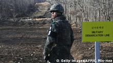 A South Korean soldier stands at Arrowhead Ridge, a site of battles in the 1950-53 Korean War, as a tactical road is built across the military demarcation line inside the Demilitarized Zone (DMZ) in the central section of the inter-Korean border in Cheorwon, Gangwon Province, in South Korea on November 22, 2018. - North and South Korea have connected a road across their shared border for the first time in 14 years, Seoul's defence ministry said on November 22 in the latest reconciliation gesture between the neighbours. (Photo by Kim Min-Hee / POOL / AFP) (Photo credit should read KIM MIN-HEE/AFP/Getty Images)
