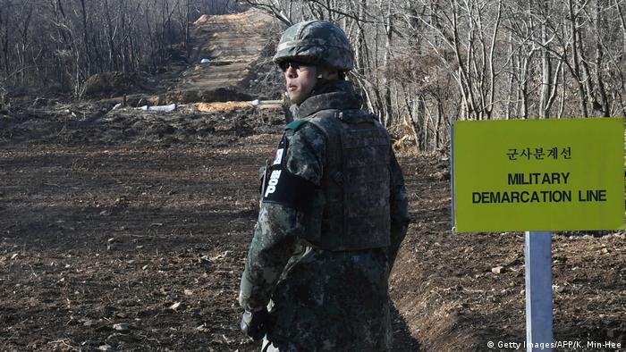 A South Korean soldier stands guard at Arrowhead Ridge, a site of battle in the 1950-53 Korean War