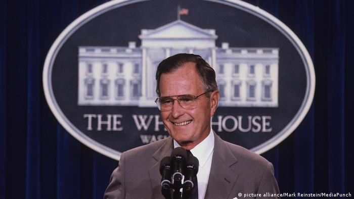 George H.W. Bush during a press conference at the White House