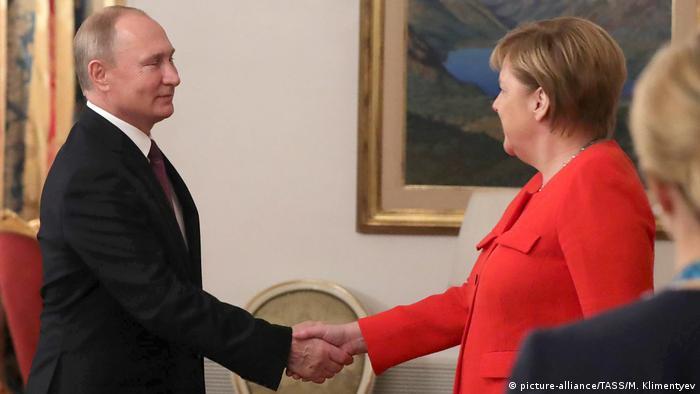 Президент Росії Володимир Путін та канцлерка ФРН Анґела Меркель під час саміту G20 в Буенос-Айресі