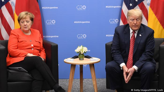 Angela Merkel and Donald Trump on the sidelines of a G-20 summit in 2018
