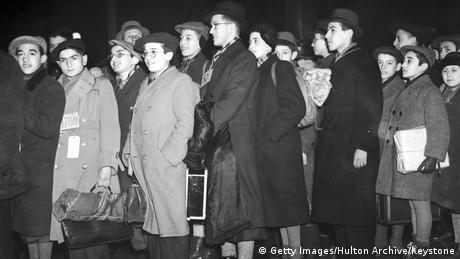 Young Jewish refugees form a line having arrived in London