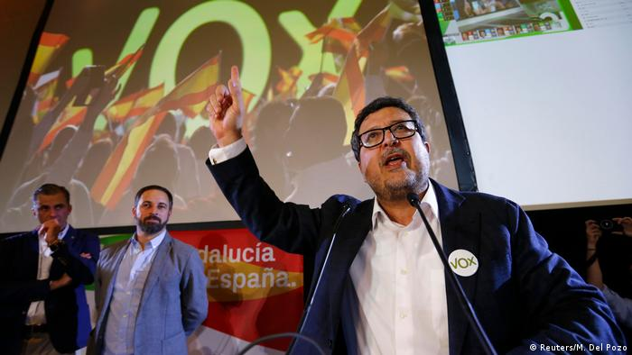 Spain's far-right VOX party regional candidate Francisco Serrano delivers a speech next to leader Santiago Abascal as they celebrate results after the Andalusian regional elections in Seville, Spain