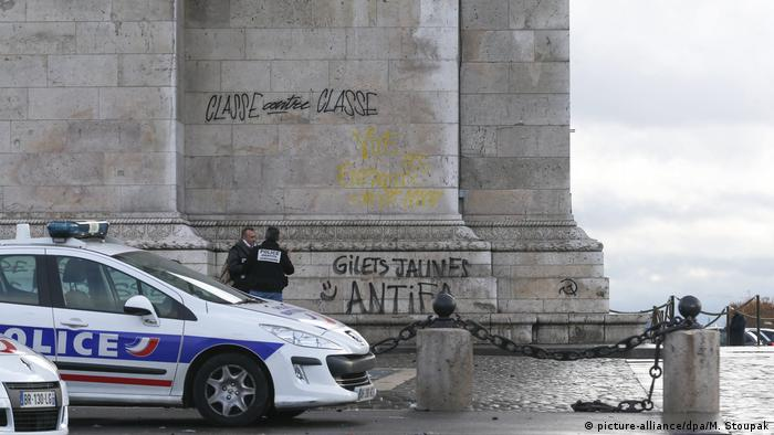 The pillars of the Arc de Triomphe monument tagged with grafitti
