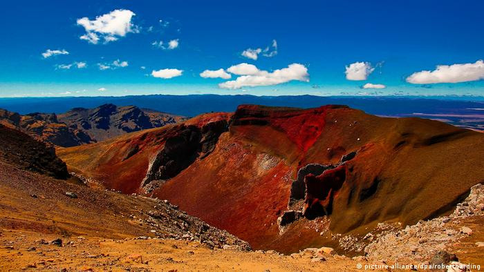New Zealand: Tongariro Alpine Crossing. A red peak against a blue sky.
