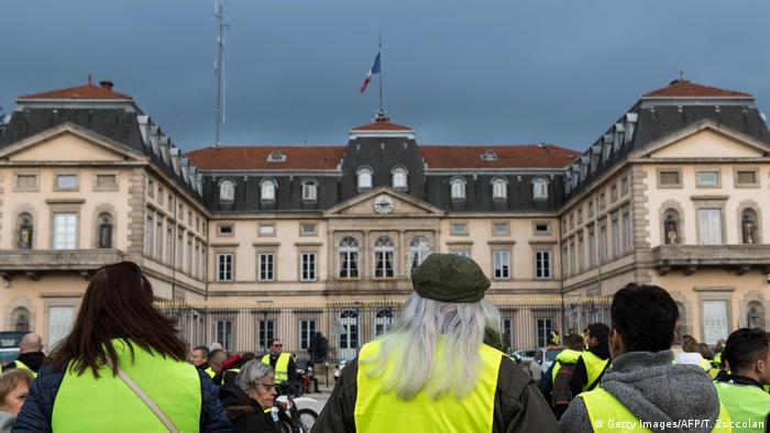 Protesters attend a gathering on November 17, 2018, in Le Puy-en-Velay, central France, as part of a nationwide people's initiated day of protest called yellow vests