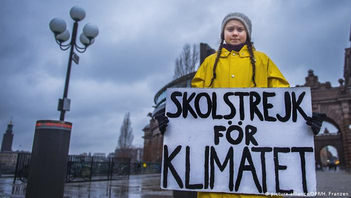 Then 15-year-old Greta Thunberg holds a banner reading school strike for the climate in front of the Swedish parliament