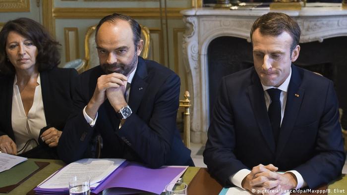 La ministra de Sanidad, Agnès Buzyn; el primer ministro Édouard Philippe; y el presidente Emmanuel Macron.