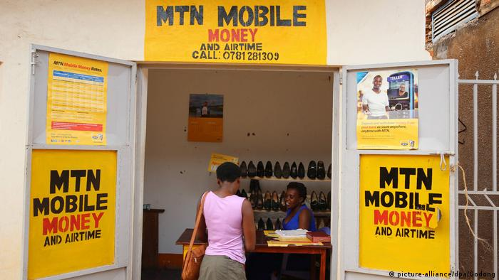 A women at a mobile money stand