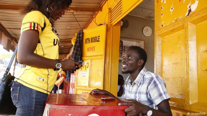 A woman in Uganda at a mobile money vendor
