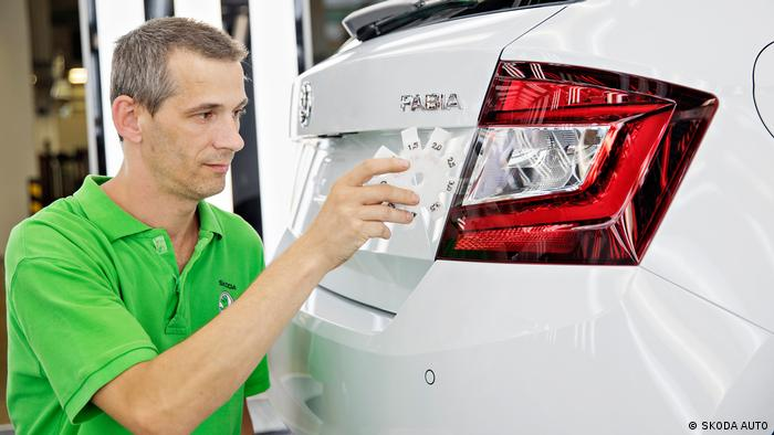 SKODA AUTO employee checking a Fabia car