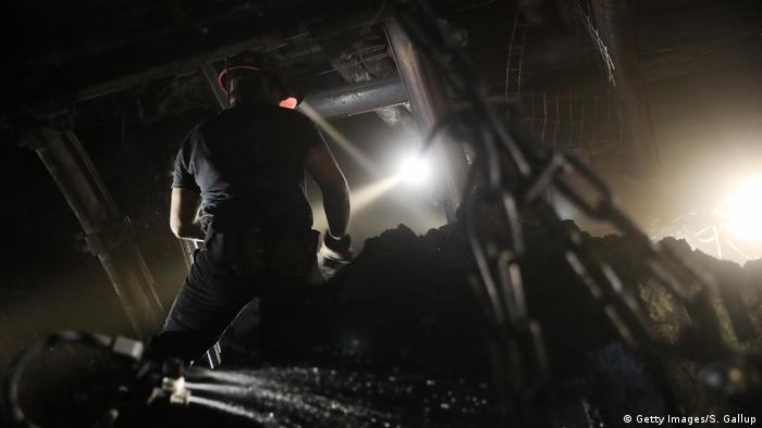 people working in a coal mine