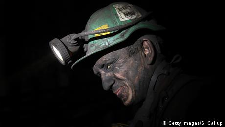 Face of a miner in the darkness, deep down in a coal mine (Getty Images/S. Gallup)