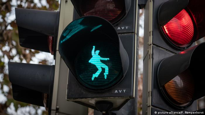 A green light showing Elvis Presley swinging his hips