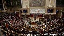 Parliament members listen to French Prime Minister Edouard Phillippe during an emergency debate in France's National Assembly over the fuel protests in Paris, Wednesday Dec.5, 2018. The concessions made by French president Emmanuel Macron's government in a bid to stop the huge and violent anti-government demonstrations seemed on Wednesday to have failed to convince protesters, with trade unions and disgruntled farmers now threatening to join the fray. (AP Photo/Michel Euler) |