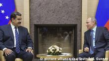 05.12.2018, Russland, Moskau: 5721495 05.12.2018 Russian President Vladimir Putin speaks to Venezuelan President Nicolas Maduro, left, during their meeting, at the Novo-Ogaryovo residence outside Moscow, Russia. Sergey Guneev / Sputnik Foto: Sergey Guneev/Sputnik/dpa  