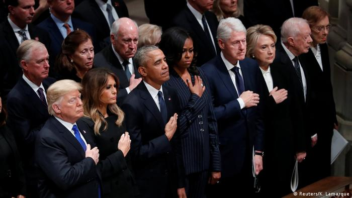 U.S. President Donald Trump and first lady Melania Trump stand with former President Barack Obama, former first lady Michelle Obama, former President Bill Clinton, former first lady Hillary Clinton, former President Jimmy Carter and former first lady Rosalynn Carter in the front row at the state funeral for former U.S. President George H.W. Bush at the Washington National Cathedral in Washington, U.S., December 5, 2018 (Reuters/K. Lamarque)