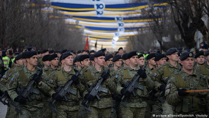 Participants in a military parade as part of celebrations for the 10th anniversary of Kosovo's independence