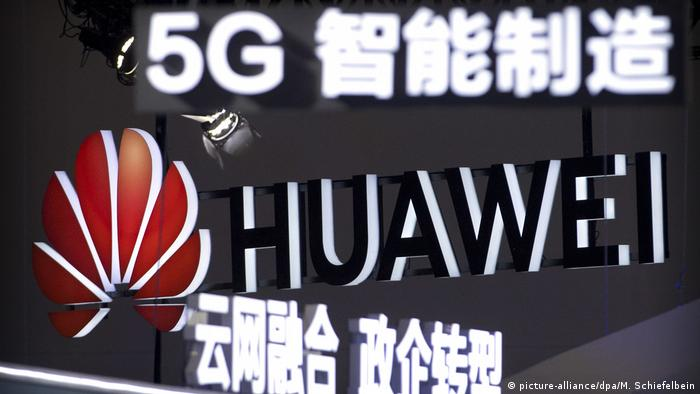 Huawei logo on a sign promoting 5G wireless technology