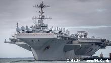 PORTSMOUTH, ENGLAND - OCTOBER 08: The US warship USS Harry S. Truman is pictured anchored in The Solent on October 8, 2018 near Portsmouth, England. The nuclear powered aircraft carrier, named after the 33rd President of the United States with a crew of more than 5,000, has been at sea since late August and has been on operations in the North Atlantic, Mediterranean and Arabian Gulf. The Nimitz-class ship, launched in 1998 andcarries more than 70 helicopters and fixed-wing aircraft, arrived in The Solent on Saturday for a five-day stay. (Photo by Matt Cardy/Getty Images)