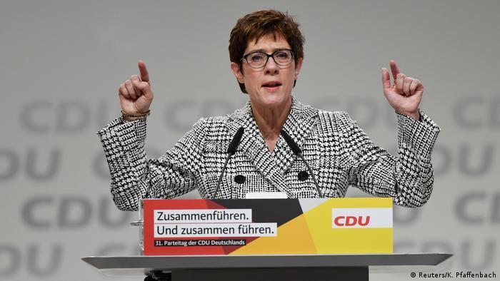 Annegret Kramp-Karrenbauer gestures while speaking (Reuters/K. Pfaffenbach)