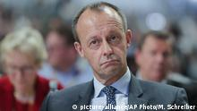 Friedrich Merz, front, center, party member and candidate for the party chairmanship listen to speeches during a party convention of the Christian Democratic Party CDU in Hamburg, Germany, Friday, Dec. 7, 2018. 1001 delegates are electing a successor of German Chancellor Angela Merkel who doesn't run again for party chairmanship after more than 18 years at the helm of the party. (AP Photo/Markus Schreiber)  