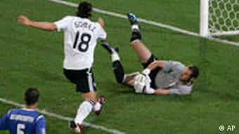 Azerbaijan's goal keeper Aghayev, right, makes a saves against Gomez
