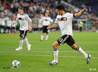 Germany's Michael Ballack, kicks the ball