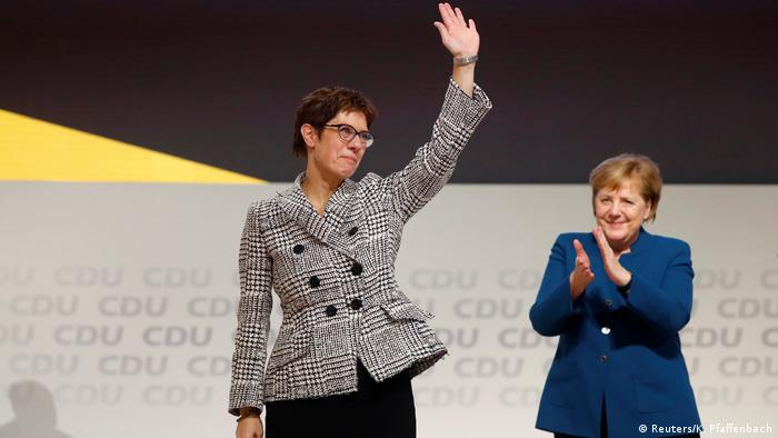 CDU chairwoman Kramp-Karrenbauer stands next to German Chancellor Angela Merkel (Reuters/K. Pfaffenbach)
