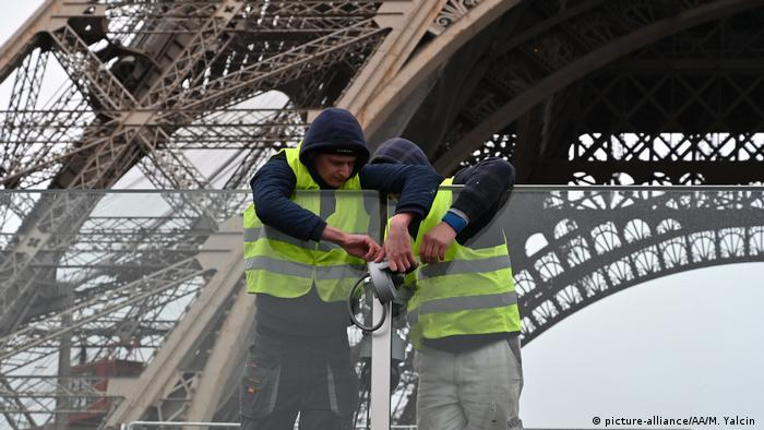 Workers controls security cameras of the Eiffel Tower