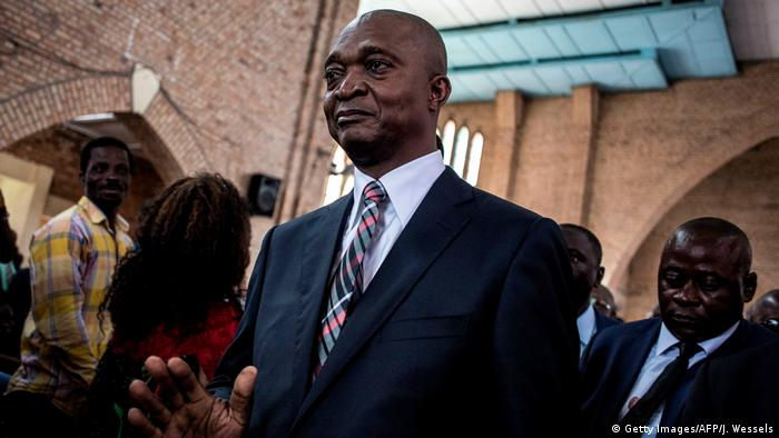 Official DRCongo presidential candidate Emmanuel Ramazani Shadary gestures inside the Cathedral Notre-Dame