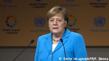German Chancellor Angela Merkel speaks during the United Nations conference on migration in the Moroccan city of Marrakesh on December 10, 2018. - The Global Compact for Safe, Orderly and Regular Migration was finalised at the UN in July after 18 months of talks and is due to be formally adopted with the bang of a gavel at the start of the two-day conference in Marrakesh. The conference adopted a migration pact in front of leaders and representatives from around 150 countries in Morocco today, despite a string of withdrawals driven by anti-immigrant populism. (Photo by Fadel SENNA / AFP) (Photo credit should read FADEL SENNA/AFP/Getty Images)