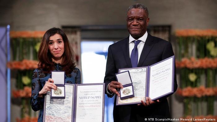 Denis Mukwege and Nadia Murad collect their prize