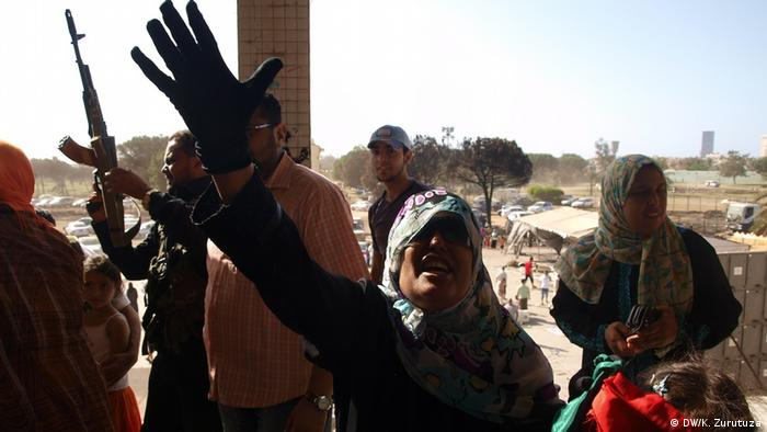 Women in Gadhafi's former bunker when rebels took over in 2001