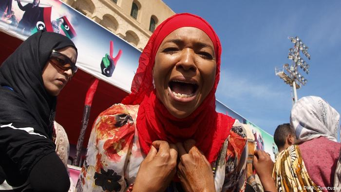 A displaced woman from Tawergha protests in downtown Tripoli, Libya