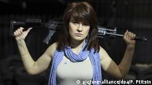 In this photo taken on Sunday, April 22, 2012, Maria Butina, a gun-rights activist, poses for a photo at a shooting range in Moscow, Russia. When gun activist Maria Butina arrived in Washington in 2014 to network with the NRA, she was peddling a Russian gun rights movement that was already dead. Fellow gun enthusiasts and arms industry officials describe the strange trajectory of her Russian gun lobby project, which U.S. prosecutors say was a cover for a Russian influence campaign. Accused of working as a foreign agent, Butina faces a hearing Monday, Sept. 10 in Washington. (AP Photo/Pavel Ptitsin) |